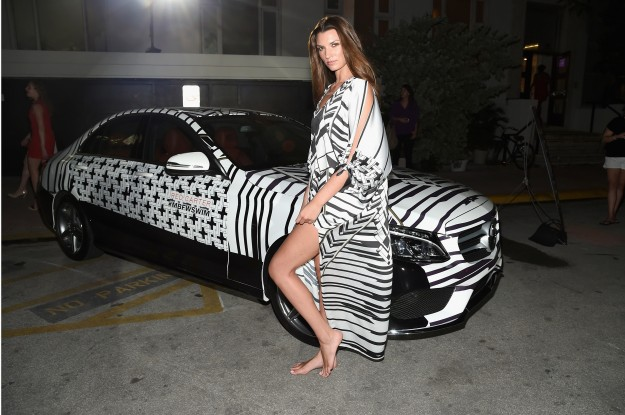 A model poses with a 2015 Mercedes-Benz C Class featuring an exclusive Design by Red Carter