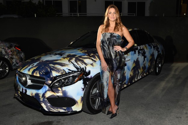 Designer Sue Di Chio 2015 poses with a Mercedes-Benz C-Class featuring an exclusive design by Suboo
